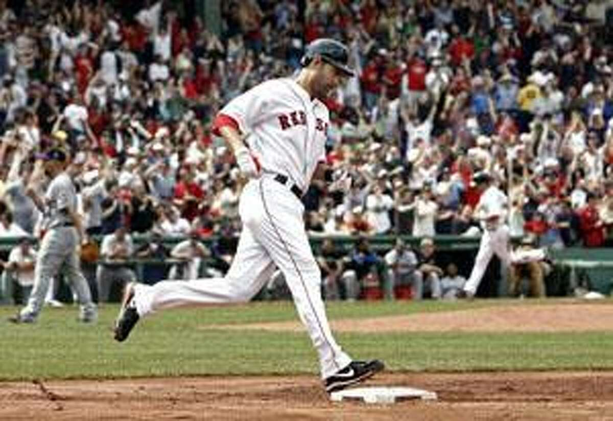 In this May 24 file photo, Boston Red Sox's Mike Lowell rounds the bases after hitting a three-run home run off New York Mets pitcher Tim Redding, left, at Fenway Park in Boston. The Boston Red Sox are discussing a trade that would send 2007 World Series MVP Mike Lowell to the Texas Rangers.