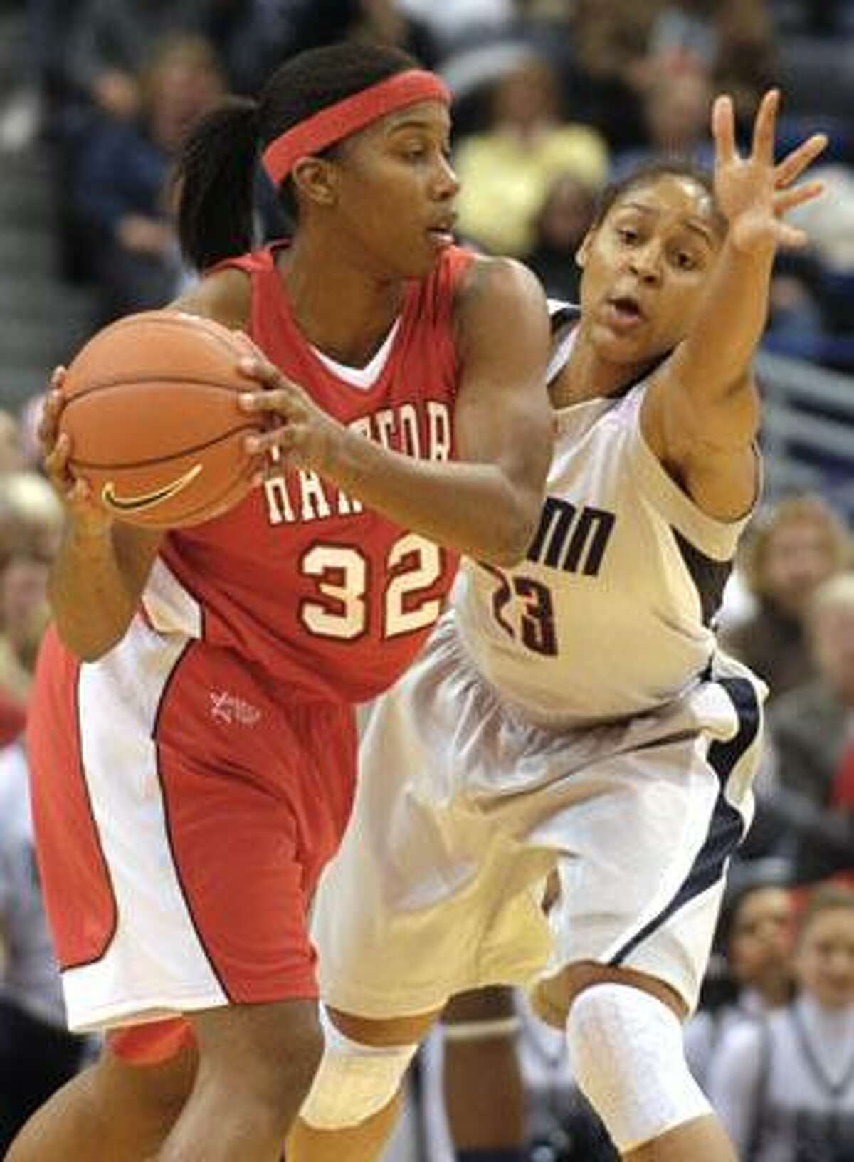 Connecticut's Maya Moore, right, guards Hartford's Erica Beverly during the first half Thursday night in Hartford.