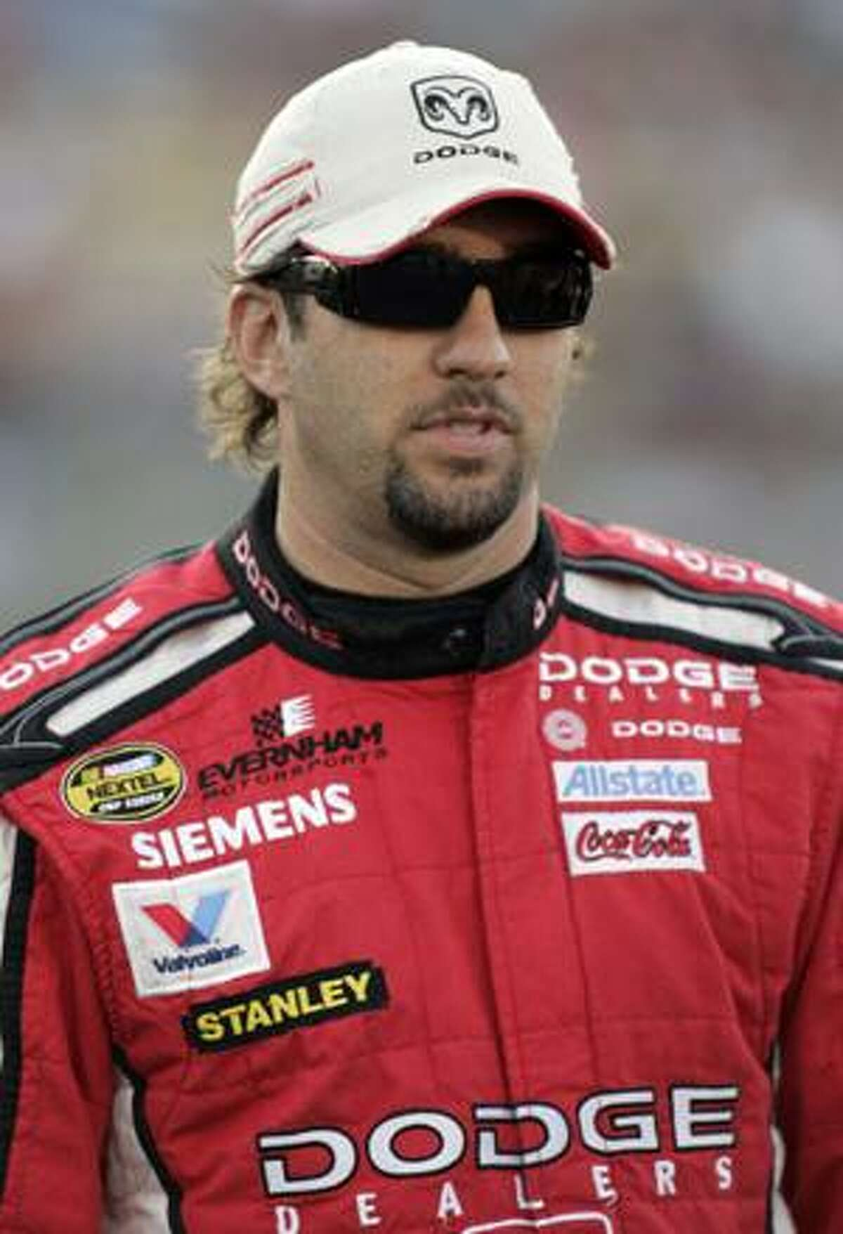This May 24, 2007 file photo shows Elliott Sadler before qualifying for the NASCAR Nextel Cup series Coca-Cola 600 auto race at Lowe's Motor Speedway in Concord, N.C. The future is uncertain, though, for one of NASCAR's most likable drivers. He's in the midst of his sixth consecutive winless season, and his prospects of landing a solid ride in the Sprint Cup Series are fading with each week. (AP Photo/Terry Renna,File)