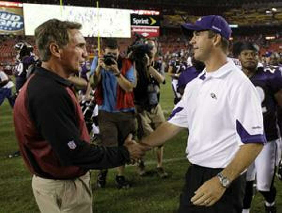AP Washington Redskins head coach Mike Shanahan, left, shakes hands with Baltimore Ravens head coach John Harbaugh after a preseason game on Aug. 21 in Landover, Md. Shanahan met with troubled defensive lineman Albert Haynesworth today, but preferred to keep the conversatoin details private.