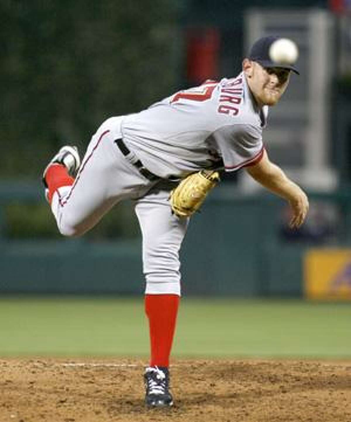 Washington Nationals' starting pitcher Stephen Strasburg throws against the Philadelphia Phillies in the second inning of a baseball game Saturday, Aug. 21, 2010, in Philadelphia. (AP Photo/H. Rumph Jr)
