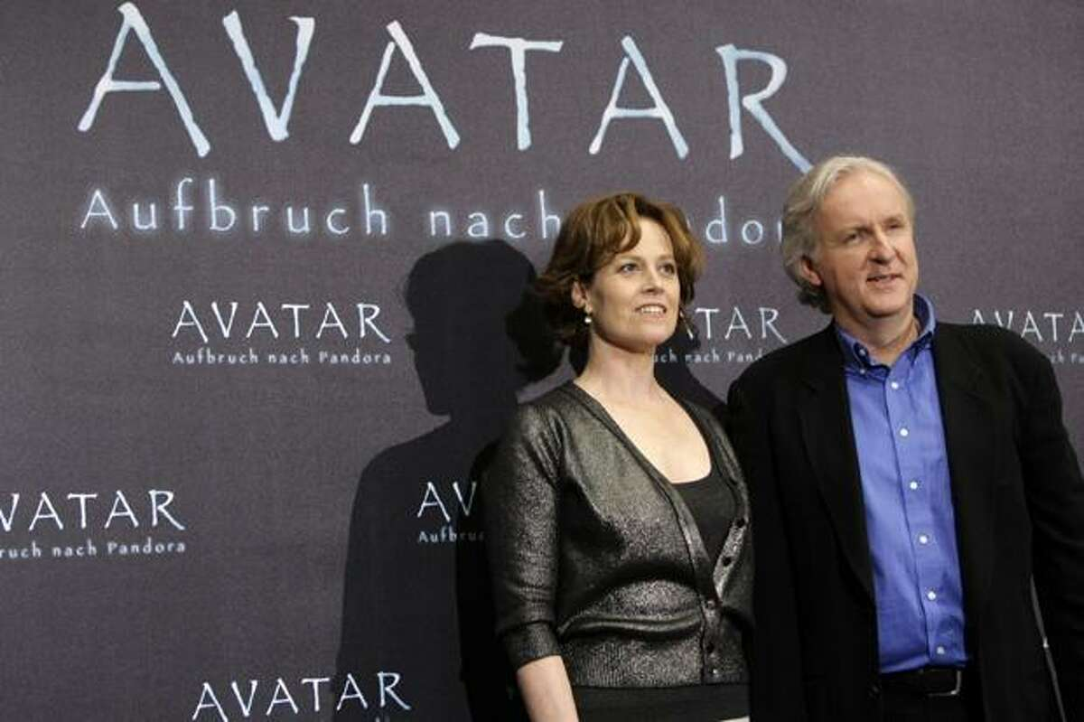 U.S. actress Sigourney Weaver, left, and Canadian born director James Cameron pose at a photo-call to promote the new movie 'Avatar' in Berlin, Germany, Tuesday.