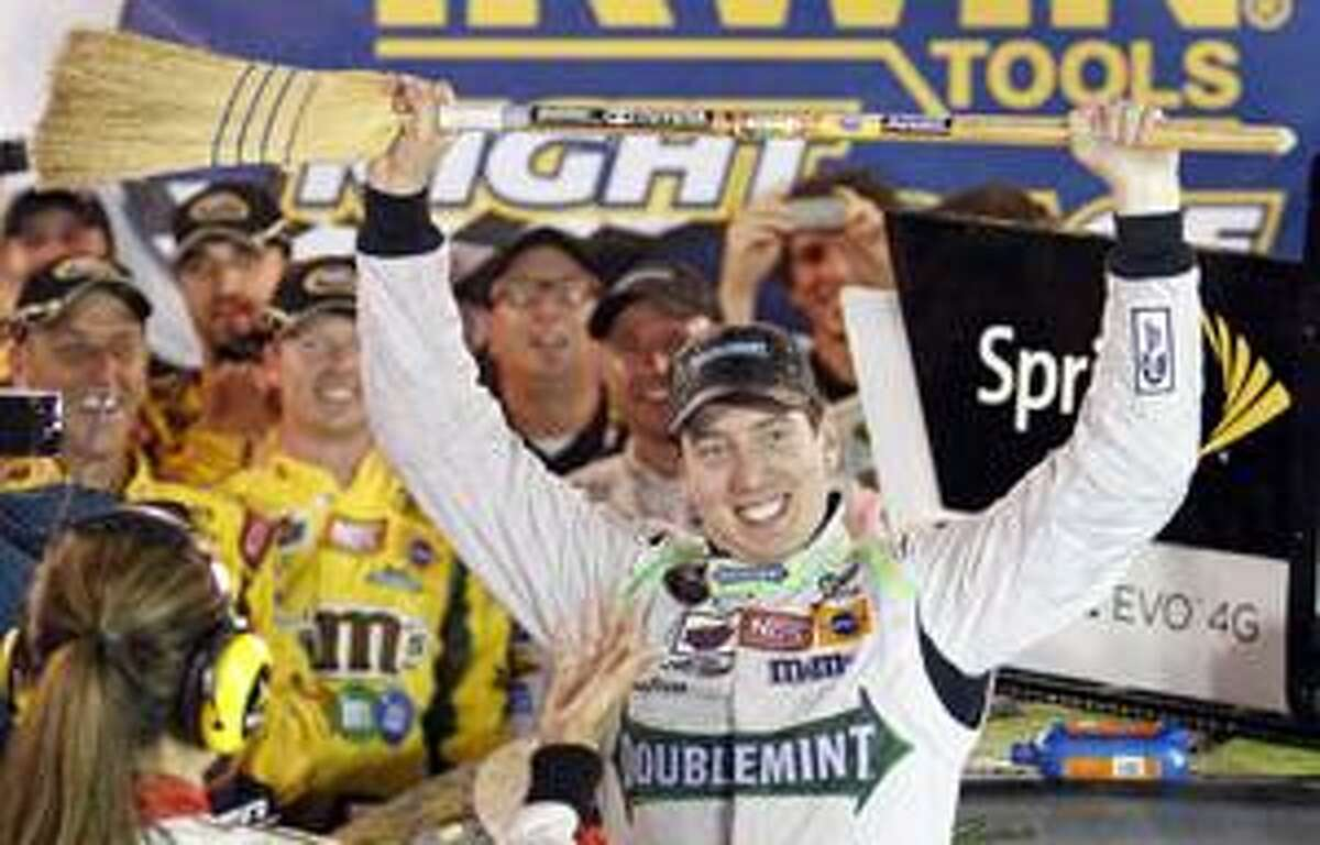 Kyle Busch celebrates in victory lane with a broom after winning the NASCAR auto racing Irwin Tools Night Race on Saturday, Aug. 21, 2010 in Bristol, Tenn. Busch swept all three races held in Bristol this week. (AP Photo/Mark Humphrey)