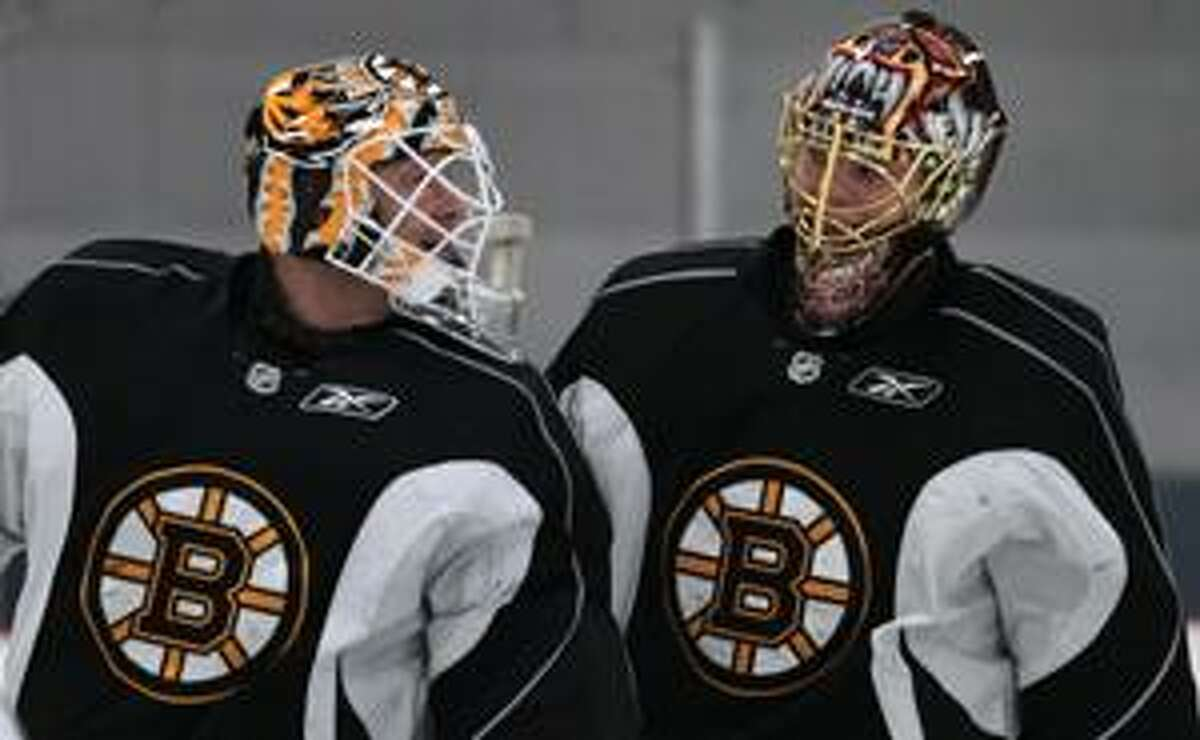Boston Bruins goalies Tim Thomas, left, and Tuukka Rask, of Finland, right, skate during a morning workout at their practice facility in Wilmington, Mass., Tuesday, April 13, 2010. The Bruins will face the Buffalo Sabres in the first round of the NHL playoffs.(AP Photo/Charles Krupa)
