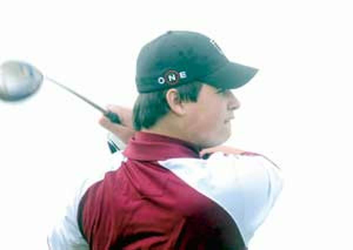MIC NICOSIA/Register Citizen Torrington's Nick Tedesco eyes his drive during Tuesday's match with Naugatuck at the Torrington Country Club. Purchase a glossy print of this photo and more at www.registercitizen.com.