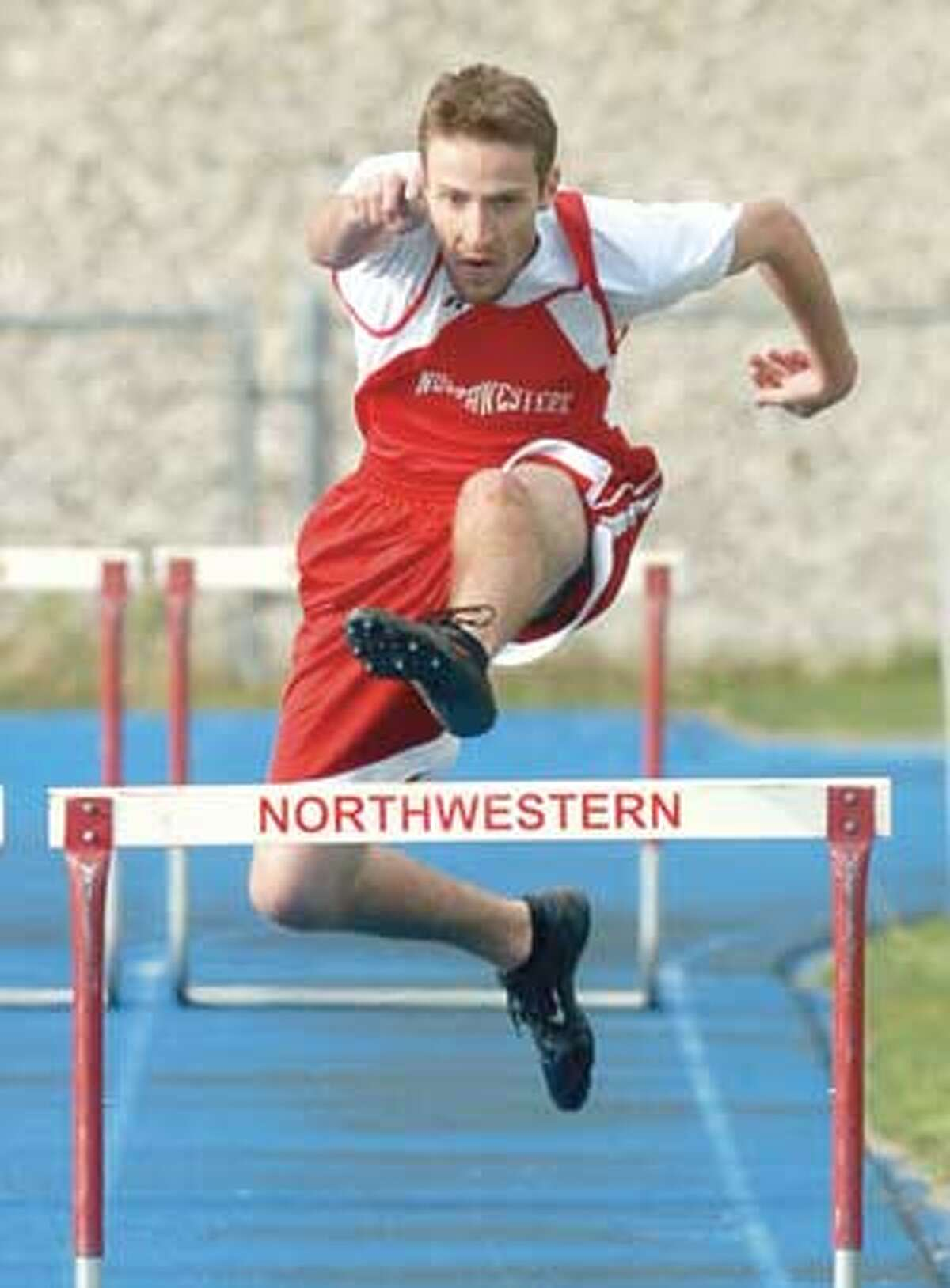 MIC NICOSIA/Register Citizen Northwestern's Jason Boratko competes in the 300 meter hurdles event during Tuesday's meet with Nonnewaug in Winsted. Purchase a glossy print of this photo and more at www.registercitizen.com.