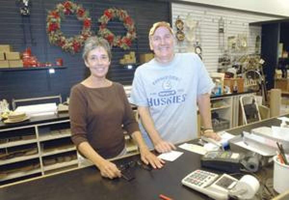 Mic Nicosia/Register Citizen Owner Kevin Considine and longtime store manager Karen Tedesco stand behind the counter of Torrington's China Shop, which will close its doors at the end of the month after more than a half-century in business.