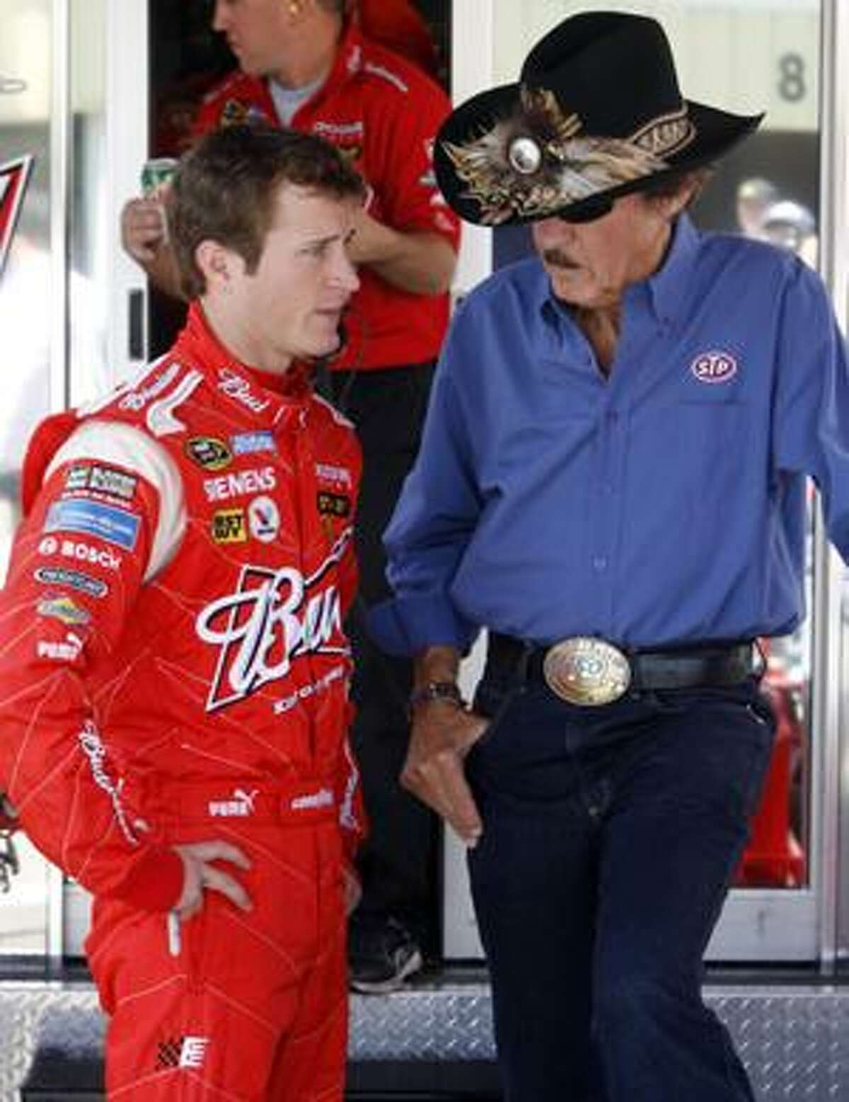 FILE - In this June 26, 2009, file photo, Kasey Kahne, left, talks with car owner Richard Petty before practice for a NASCAR auto race in Loudon, N.H. Kahne is in the final stages of completing a deal to drive for Hendrick Motorsports in 2012, The Associated Press has learned. A person familiar with Kahne's plans spoke to the AP on the condition of anonymity Tuesday, April 13, because portions of Kahne's deal are still being worked out. (AP Photo/Toby Talbot, File)