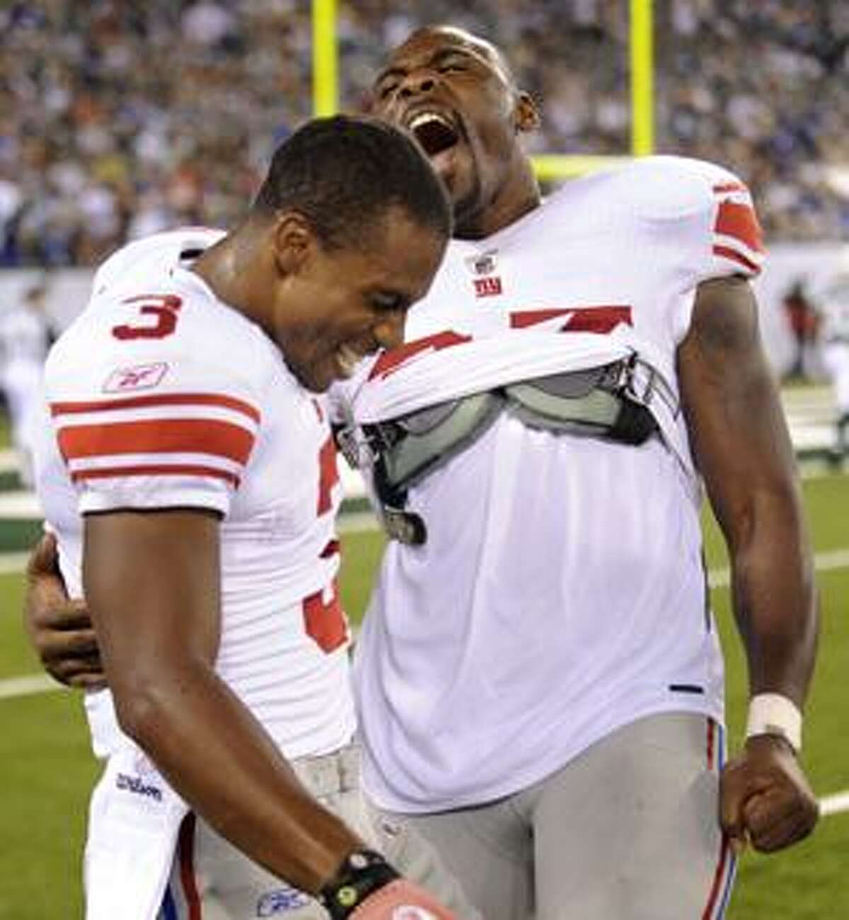 New York Giants' Victor Cruz, left, celebrates with Brandon Jacobs during the fourth quarter after scoring his second touchdown of a preseason NFL football game at New Meadowlands Stadium in East Rutherford, N.J., Monday, Aug. 16, 2010. The Giants defeated the New York Jets 31-16. (AP Photo/Bill Kostroun)