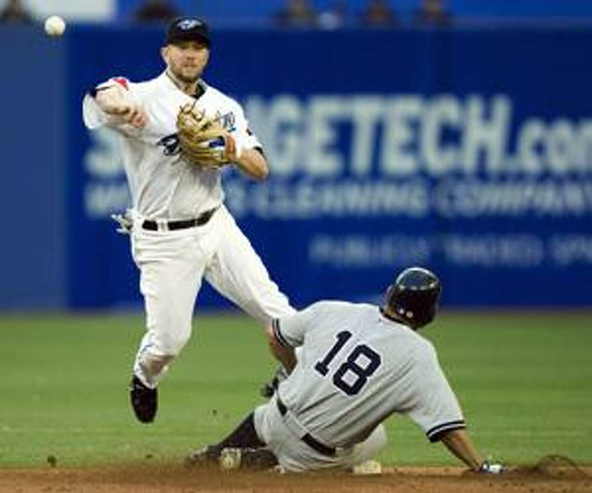 AP Toronto Blue Jays second baseman Aaron Hill gets the force out of New York Yankees' Johnny Damon (18) on a grounder by the Yankees' Mark Teixeira during the third inning in Toronto on Wednesday. Derek Jeter scored on the play, and Teixeira was safe at first.