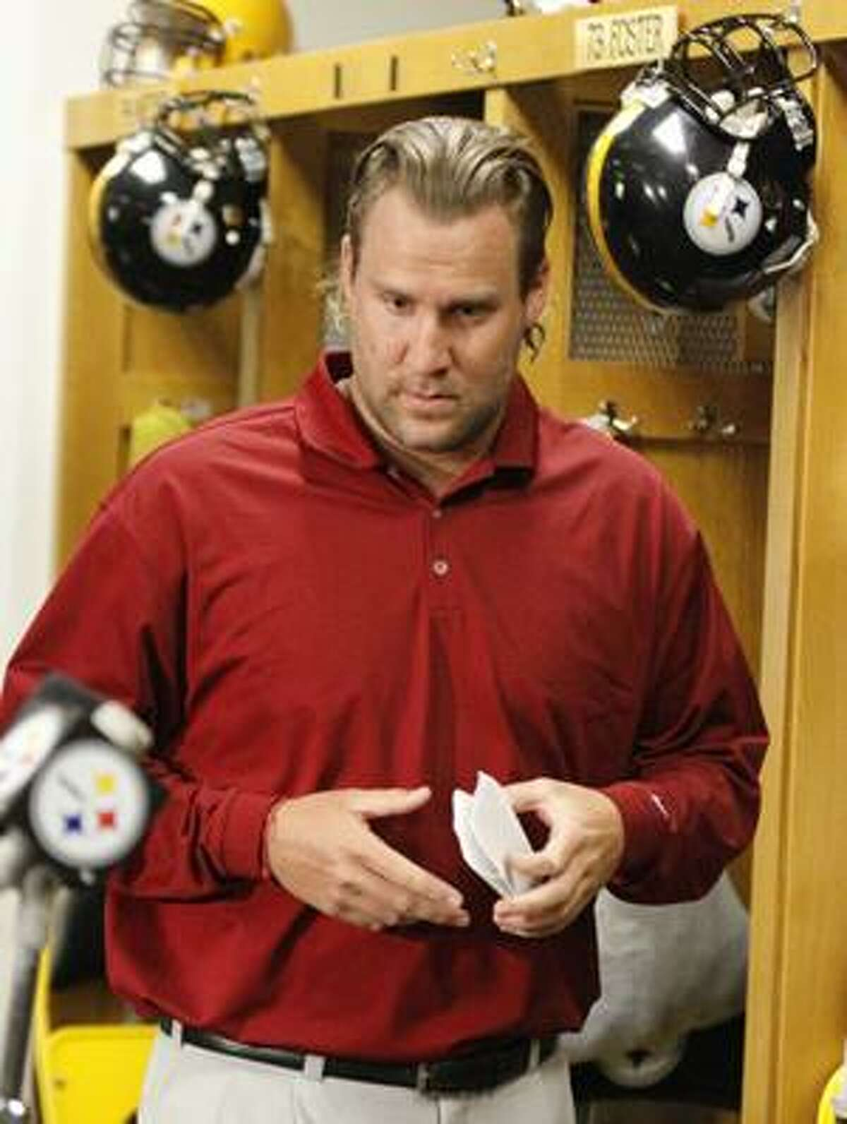 Pittsburgh Steelers quarterback Ben Roethlisberger prepares to read a statement in the NFL football team's locker room Monday, April 12, 2010, in Pittsburgh. Roethlisberger says he is