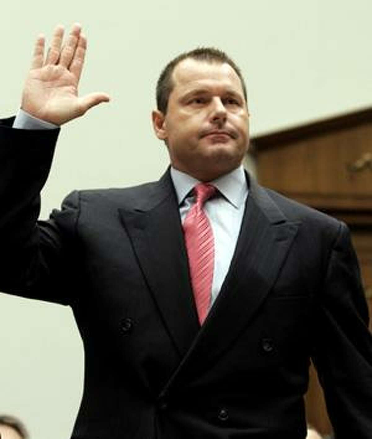 FILE - This Feb. 13, 2008, file photo shows former New York Yankees baseball pitcher Roger Clemens being sworn-in on Capitol Hill in Washington, prior to testifying before the House Oversight, and Government Reform committee hearing on drug use in baseball. The New York Times reported on its website Thursday, Aug. 19, 2010, that federal authorities have decided to indict Roger Clemens on charges of making false statements to Congress about his use of performance-enhancing drugs. (AP Photo/Susan Walsh, File)