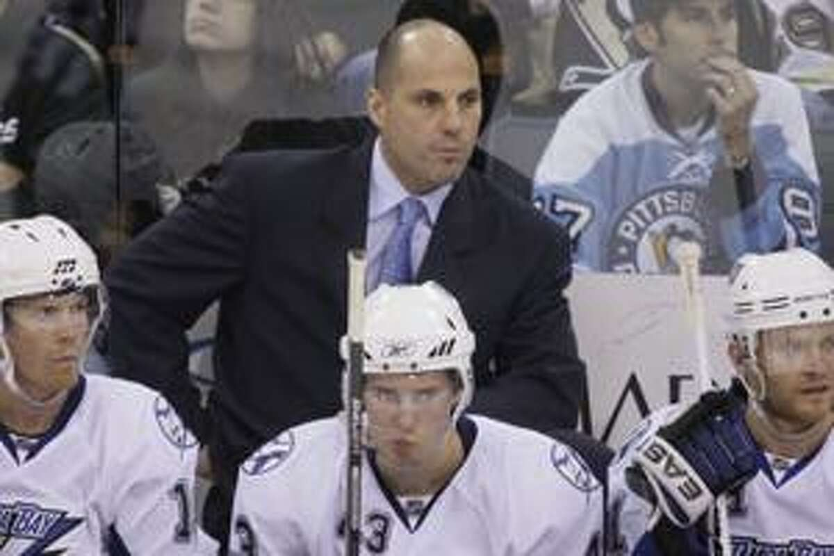 FILE - This Oct. 17, 2009, file photo shows Tampa Bay Lightning coach Rick Tocchet behind players on the bench in the third period of an NHL hockey game in Pittsburgh. The Tampa Bay Lightning have fired coach Rick Tocchet and general manager Brian Lawton. Team owner Jeff Vinik made the announcement Monday, April 12, 2010, one day after the Lightning ended the regular season by missing the playoffs for the third consecutive year. (AP Photo/Gene J. Puskar, File)