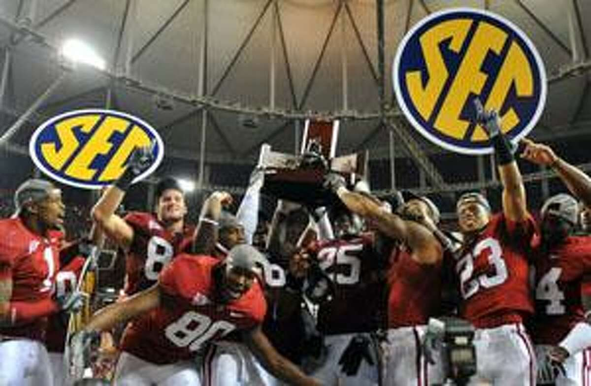 AP Alabama players celebrate after their 32-13 win over Florida in the SEC championship game at the Georgia Dome in Atlanta Saturday.