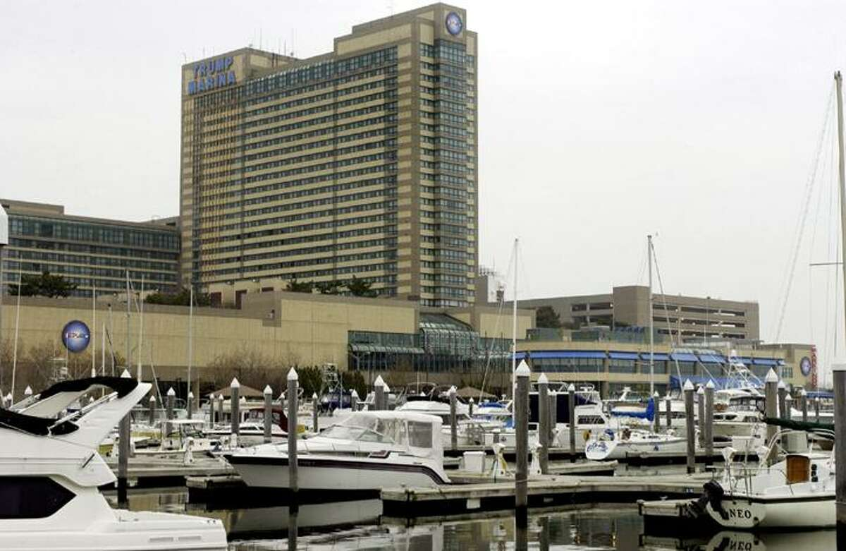 FILE - In this Nov. 22, 2004 file photograph, boats fill a marina in front of Trump Marina Hotel Casino, in Atlantic City, N.J.
