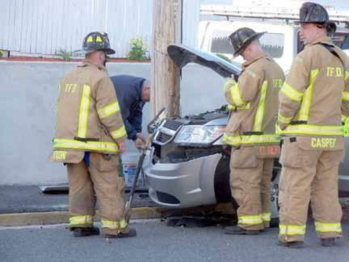 Torrington Fire Department personnel respond to a one-car crash into a utility pole that shut down power to a local restaurant.