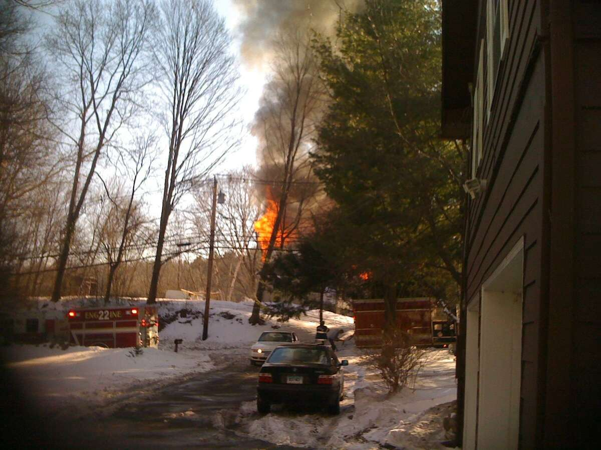 A fire destroyed a house on Silvermine Road Thursday afternoon. Photo courtesy of Alex Vishnefsky.