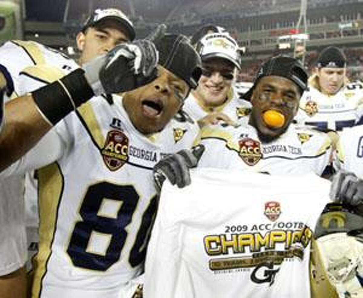 Players from Georgia Tech, including Daniel McKayhan, left, and Embry Peeples, right, celebrate Tech's 39-34 win over Clemson in the Atlantic Coast Conference Championship game Saturday in Tampa, Fla. (AP Photo/Mike Carlson)