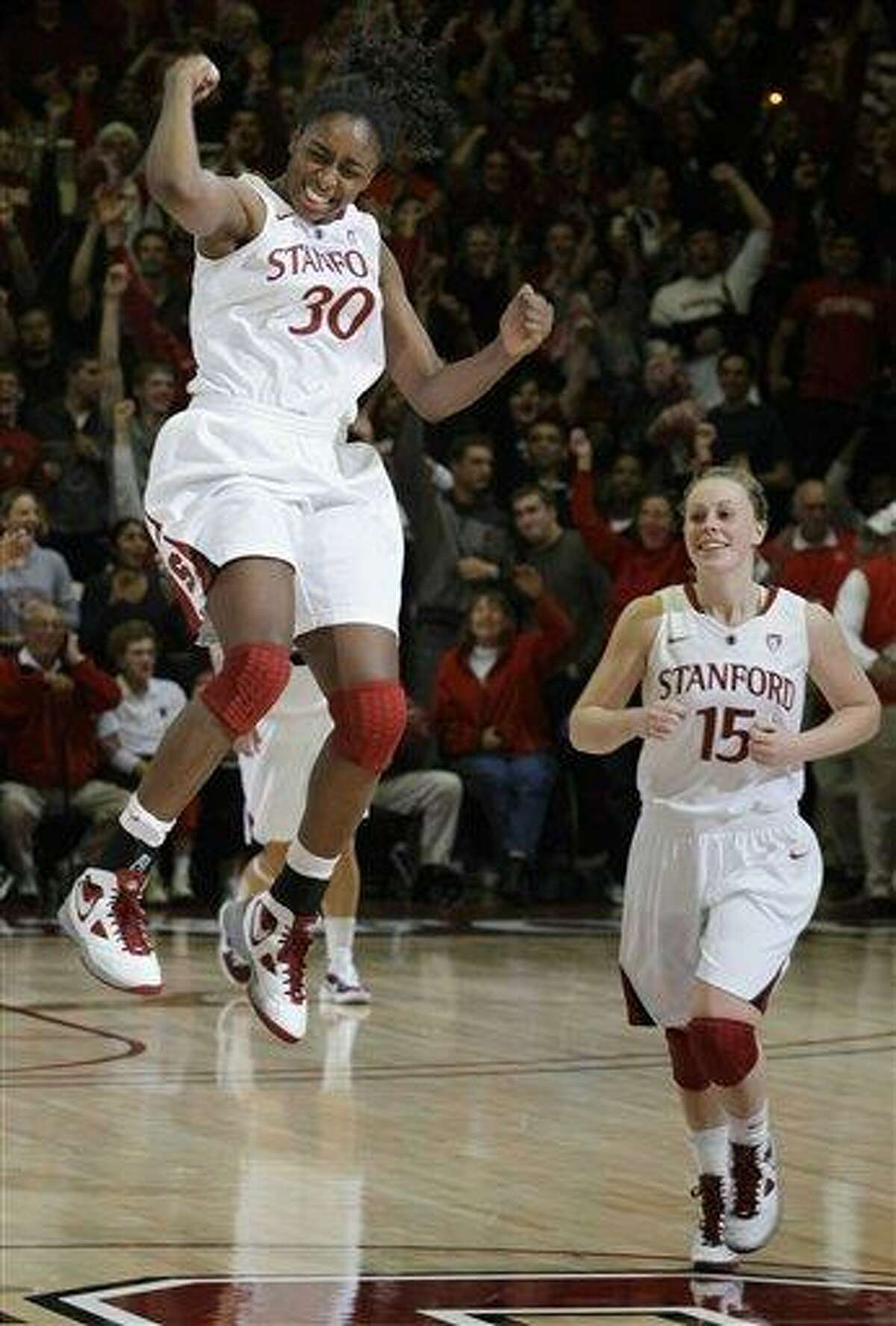 Stanford forward Nnemkadi Ogwumike (30) celebrates with guard Lindy La Rocque (15) after an NCAA college basketball game in Stanford, Calif., Thursday, Dec. 30, 2010. Stanford upset Connecticut 71-59, ending Connecticut's winning streak at 90 games. (AP Photo/Paul Sakuma)