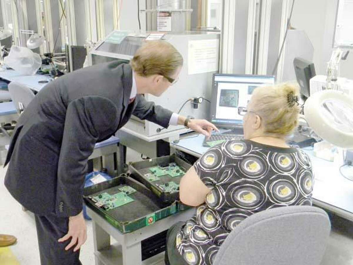 MIKE AGOGLIATI/ Register CitizenAttorney General and Senate candidate Richard Blumenthal speaks with an employee during a tour of Altek on Thursday.