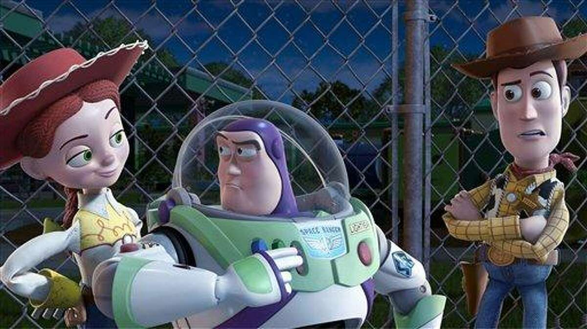 In this film publicity image released by Disney, from left, Jessie, voiced by Joan Cusack, Buzz Lightyear, voiced by Tim Allen and Woody, voiced by Tom Hanks are shown in a scene from