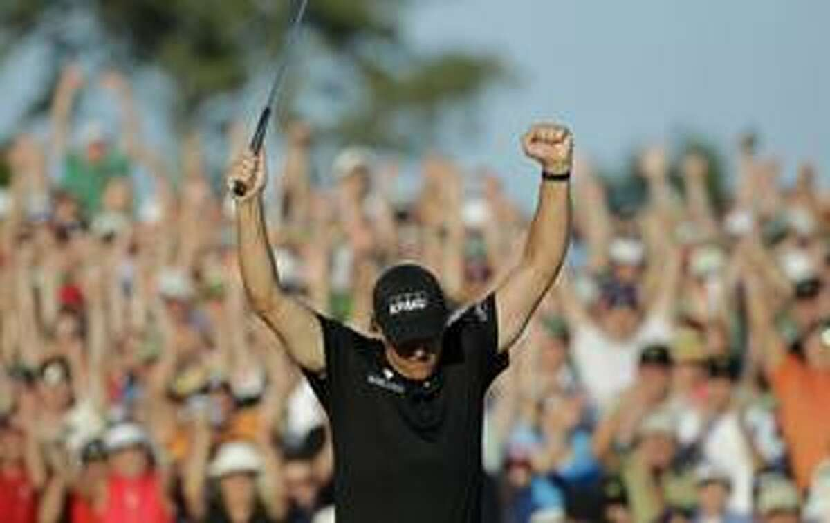 Phil Mickelson celebrates on the 18th green after winning the Masters golf tournament in Augusta, Ga., Sunday. (AP Photo/Morry Gash)