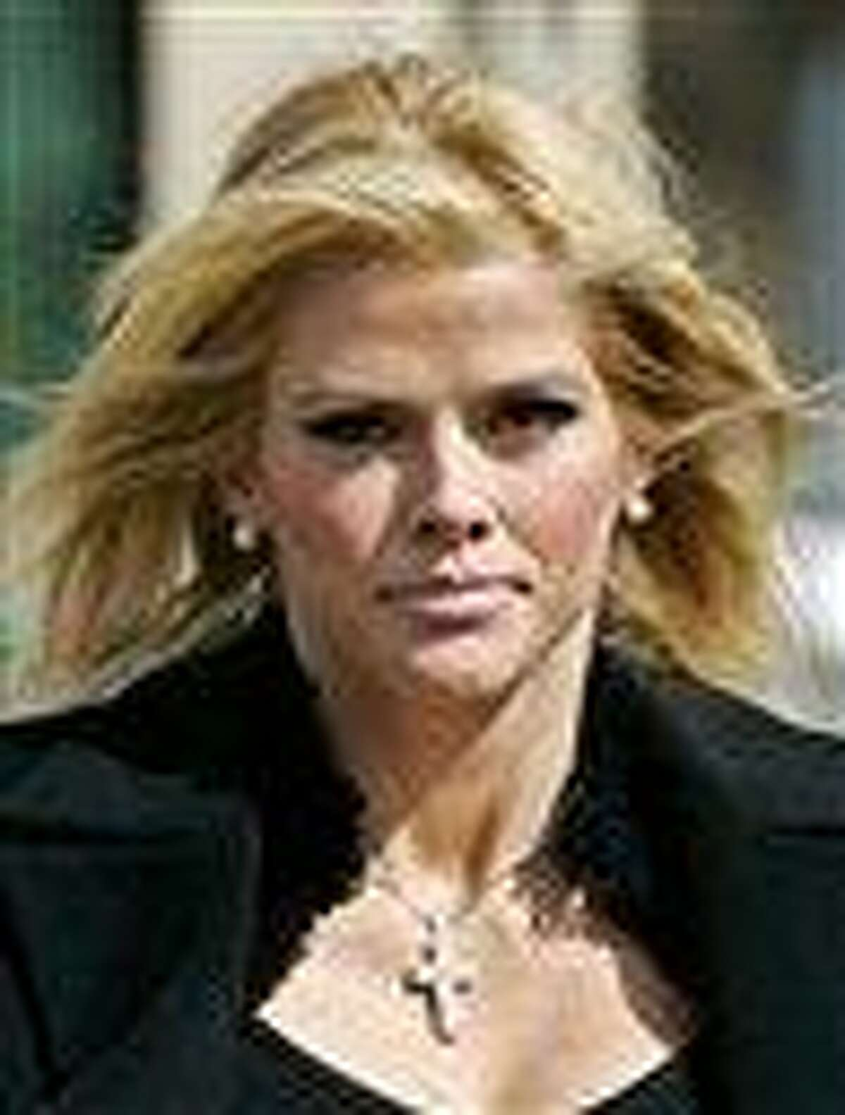 FILE - In this Feb. 28, 2006 file photo, Anna Nicole Smith, leaves the U.S. Supreme Court in Washington. A doctor for Smith says the late Playboy model had chronic pain syndrome that was a challenge to treat because she was addicted to prescription drugs. Dr. Victor Kovner testified for a second day on Wednesday, Aug. 11, 2010 in the Los Angeles trial of two other doctors and Smith's boyfriend. (AP Photo/Manuel Balce Ceneta, File)