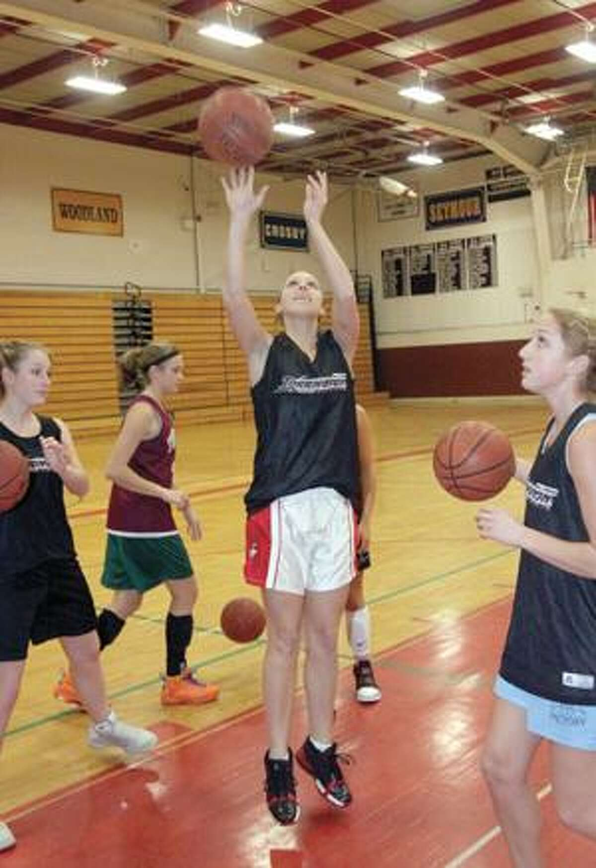 SONJA ZINKE/Register Citizen Torrington's Kayla Langenheim takes a shot during practice with her team at Torrington High School Thursday. Purchase a glossy print of this photo and more at www.registercitizen.com.