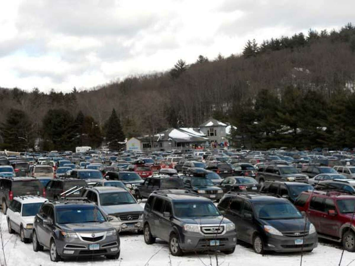 Photos by Chris Rueli Skiers' cars filled the parking lot at Ski Sundown on Tuesday.
