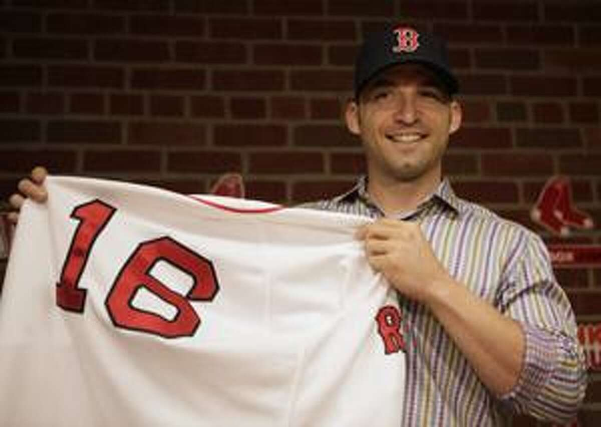 AP Newly signed Boston Red Sox shortstop Marco Scutaro displays a Red Sox uniform during a news conference at Fenway Park, in Boston, Friday. After cycling through seven shortstops since the middle of the 2004 season, the Red Sox announced on Friday that they have given Scutaro a two-year deal with a club option for 2012.