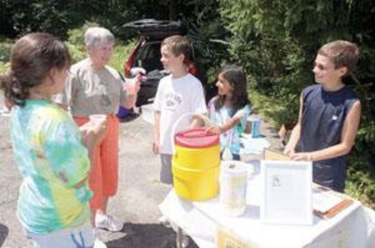 SONJA ZINKE/Register CitizenSecond from left, Pat Dupret enjoys a cold glass of lemonade from left to right, Gina Pirla, Lukas Gryniuk, Mahaila Dickinson and Mitchell Gryniuk Saturday. The children gathered on Thompson Drive in Torrington to set up Alex's Lemonade Stand to raise money to help fight childhood cancer. Purchase a glossy print of this photo and more at www.registercitizen.com