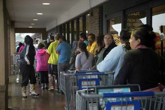 Kroger clients make a line waiting for their turn to enter the store to buy groceries during the Tropical Storm Harvey, Monday, Aug. 28, 2017, in Houston. ( Marie D. De Jesus / Houston Chronicle )