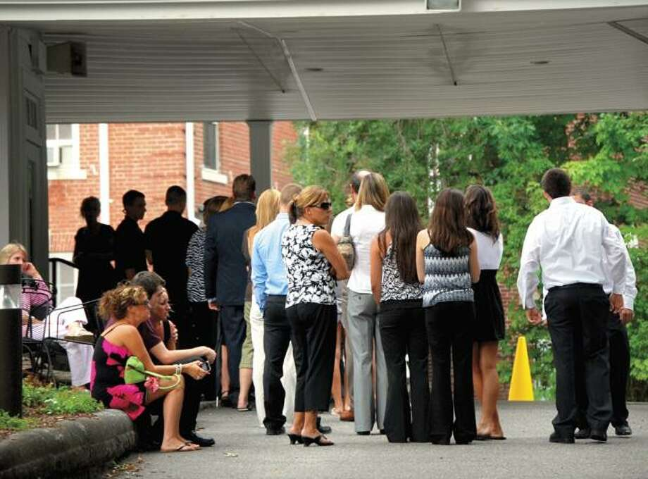 RONALD DeROSA/Register CitizenMourners wait to enter Phalen Funeral Home on Sunday during calling hours for Charles Buonocore, of Harwinton. Buonocore, 18, died in a car accident late Thursday, along with 17-year-old Mellissa Andrew. His funeral is today at 10 a.m. at Immaculate Heart of Mary church in Harwinton. Andrew's funeral is at 10 a.m. on Tuesday at St. Mary's by the Sea church in Unionville.