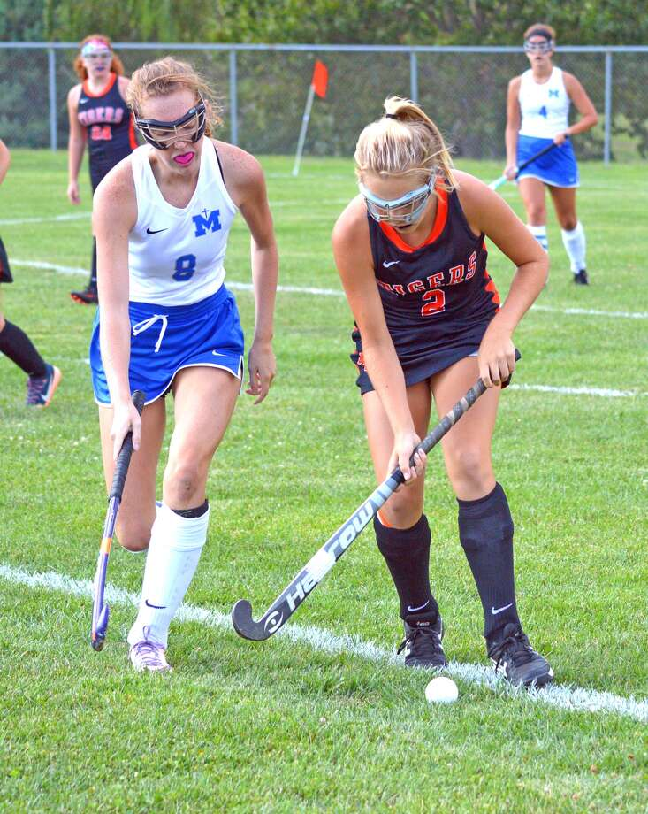 Edwardsville freshman Rachel Goebel, right, tries to keep the ball away from an Alton Marquette defender during Monday's game at Gordon Moore Park.