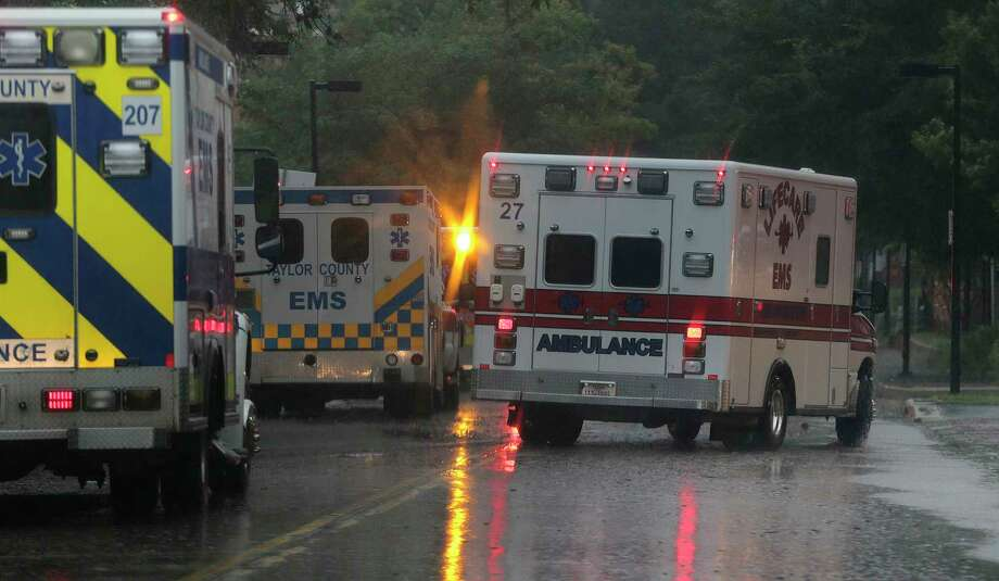 Ambulances line up to evacuate some of the ICU patients out of Ben Taub Hospital in Houston as Tropical Storm Harvey inches its way through the area on  Monday, Aug. 28, 2017. ( Elizabeth Conley / Houston Chronicle ) Photo: Elizabeth Conley, Staff / © 2017 Houston Chronicle