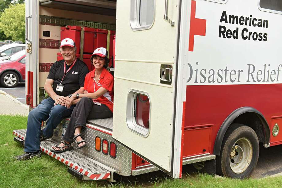 Mark and Marianne Theophilis of Clifton Park sit in back of the American Red Cross emergency response vehicle they are using to drive down to Baton Rouge, Louisiana to help victims of Hurricane Harvey on Monday, Aug. 28, 2017 in Albany, N.Y. (Lori Van Buren / Times Union) Photo: Lori Van Buren / 20041407A