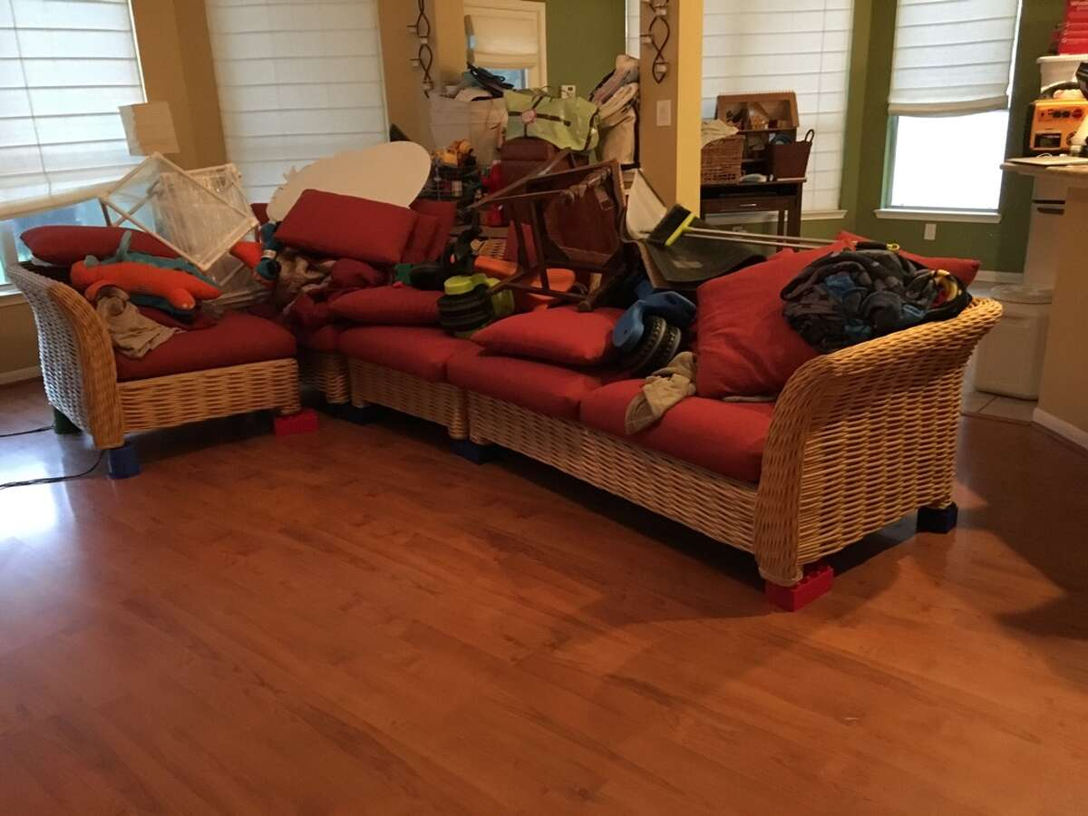 A North Houston family used large LEGO blocks to save their couch and kitchen table, among other pieces of furniture, from flooding caused by Tropical Storm Harvey.