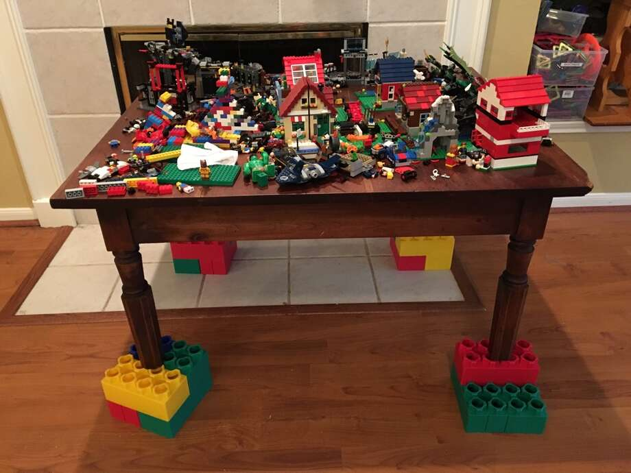A North Houston family used large LEGO blocks to save their couch and kitchen table, among other pieces of furniture, from flooding caused by Tropical Storm Harvey. Photo: Peter Wayne