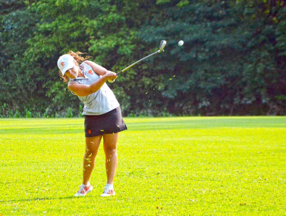 Edwardsville senior Mary Arth hits her second shot on hole No. 2 on the east nine at Oak Brook Golf Club during Monday's round against Collinsville.