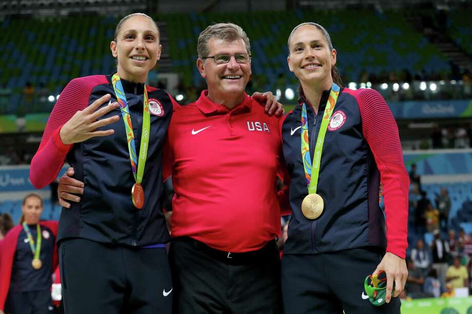 Gold medalists Diana Taurasi, left, coach Geno Auriemma and Sue Bird celebrate during the medal ceremony at Rio 2016 Olympic Games on Aug. 20, 2016 in Rio de Janeiro, Brazil. Photo: Tom Pennington / Getty Images / 2016 Getty Images