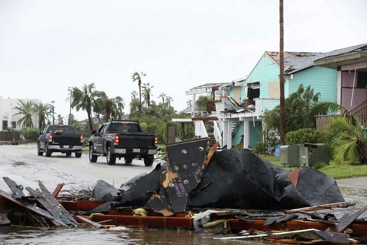 Residents and workers arrive to repair damages at homes in the affluent Key Allegro neighborhood between Fulton and Rockport, Texas Monday, August 28, 2017. The eye of Hurricane Harvey made landfall in the area Friday night.