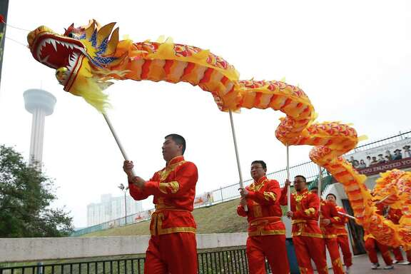 Members of the San Antonio Chinese Dragon Dance Team join in a mini-parade as the Institute of Texan Cultures hosts the 2017 Asian Festival on Feb. 4.