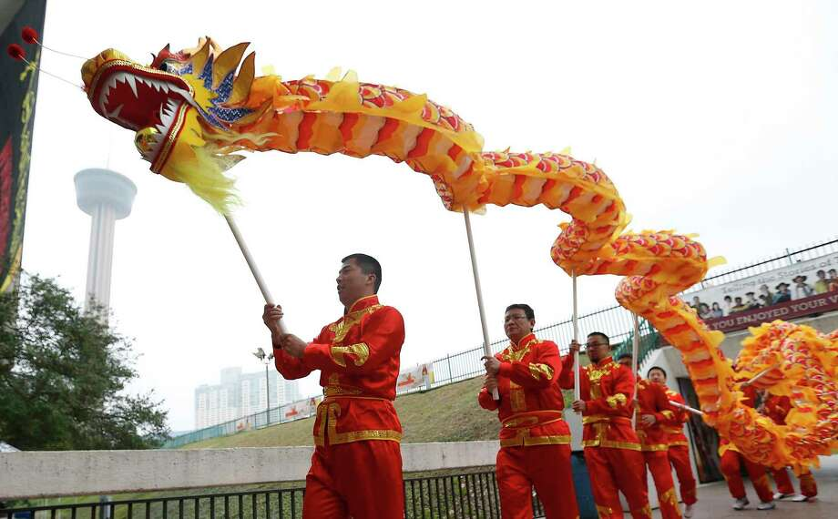 Members of the San Antonio Chinese Dragon Dance Team join in a mini-parade as the Institute of Texan Cultures hosts the 2017 Asian Festival on Feb. 4. Photo: Kin Man Hui /San Antonio Express-News / ©2017 San Antonio Express-News