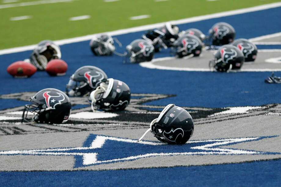 An abundance of Texans helmets adorn an end zone at the Cowboys' training facility in Frisco, where the Texans have been working out in preparation for Thursday's game against Dallas. Photo: Tony Gutierrez, STF / Copyright 2017 The Associated Press. All rights reserved.