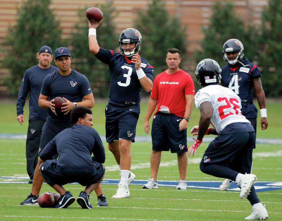 Quarterback Tom Savage (3) throws a pass to running back Lamar Miller (26) during the Texans' workout Monday morning at the Dallas Cowboys' training facility in Frisco. Photo: Tony Gutierrez, STF / Copyright 2017 The Associated Press. All rights reserved.