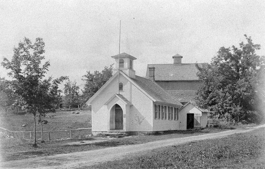 A photo of the North Canton Schoolhouse is part of an upcoming exhibit of the works of Lewis Mills.