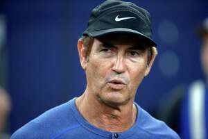 FILE - In this Sept. 25, 2016, file photo, former Baylor football coach Art Briles watches the Dallas Cowboys and the Chicago Bears warm up for an NFL football game in Arlington, Texas. The Hamilton Tiger-Cats of the Canadian Football League have hired former Baylor coach Art Briles to be an assistant. The team announced the move Monday, Aug. 28, 2017, via Twitter. (AP Photo/Ron Jenkins, File)