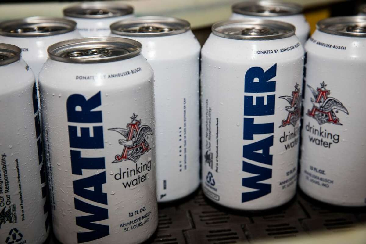 Photos: How Harvey looks to Houstonians This image from Anheuser-Busch shows the brewery's recognizable white water cans. The company is sending water to Texas in the wake of Tropical Storm Harvey. See the view of Harvey shared by Chron.com readers as the disaster unfolded.