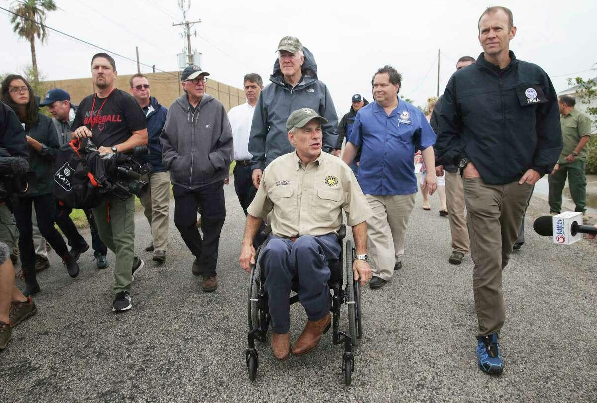 Gov. Greg Abbott tours Rockport with Sen. John Cornyn, behind Abbott and FEMA administrator Brock Long on August 28, 2017.