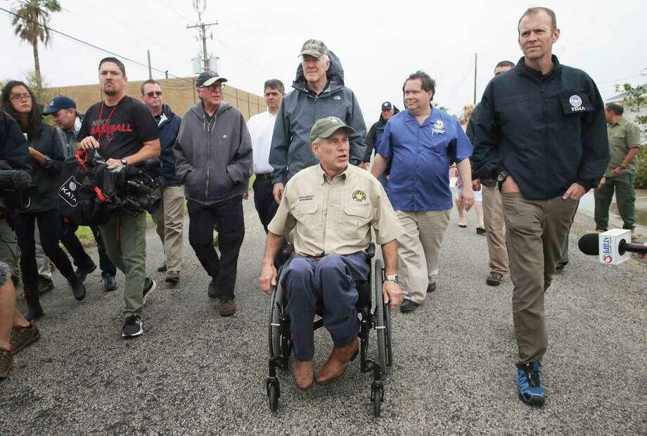Gov. Greg Abbott tours Rockport with Sen. John Cornyn, behind Abbott and FEMA administrator Brock Long on August 28, 2017. Photo: Tom Reel, San Antonio Express-News / 2017 SAN ANTONIO EXPRESS-NEWS